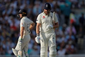 England's Jonny Bairstow looks dejected as he leaves the field after losing his wicket to a catch by Australia's Steve Smith