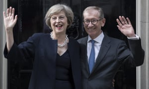 Theresa May with her and husband Philip outside 10 Downing Street on Wednesday.