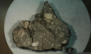 The lunar rock sample from the Apollo 15 mission. The rock consists of basalt fragments welded together by a dark glassy matrix produced by melting caused by a meteorite impact.