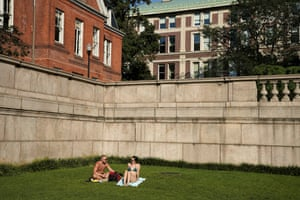People are seated on the grass a Columbia University during in New York City on 23 August.
