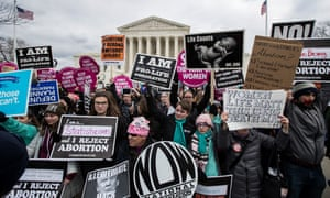 Anti-abortion and pro-choice advocates rally outside the US supreme court on the 44th anniversary of Roe v Wade.