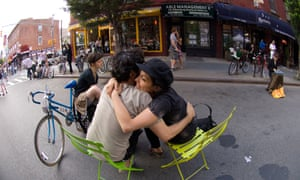 couple embracing in street in Williamsburg NY