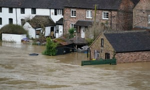 Homes are flooded on the banks of the River Severn following Storm Dennis on February 18, 2020 in Ironbridge, England. Storm Dennis is the second named storm to bring extreme weather in a week and follows in the aftermath of Storm Ciara. Although water is residing in many places flood warnings are still in place. (Photo by Christopher Furlong/Getty Images)
