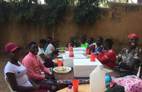 Nickson Avaye celebrating his 20th birthday at a long table with friends