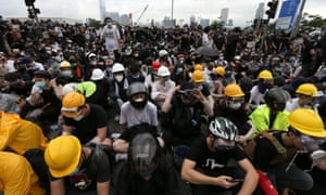 Protesters wear helmets, masks and protective gear, in anticipation of tear gas and violence from police.