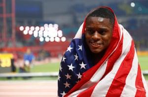 Christian Coleman celebrates winning gold.
