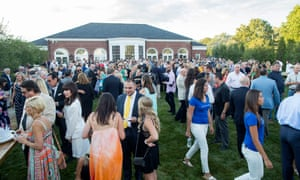 Guests socialize during Ernie Boch Jr's annual summer bash and fundraiser in Norwood, Massachusetts.