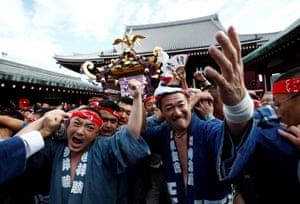 People carrying a portable shrine, a Mikoshi, at the Senso-ji Temple