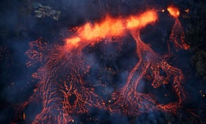 A fissure eruption fountains more than 200ft into the air, consuming all in its path, near Pahoa.