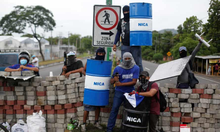 Demonstrators stand at a barricade during a protest against Daniel Ortega's government in Nindirí, Nicaragua, on 5 June.