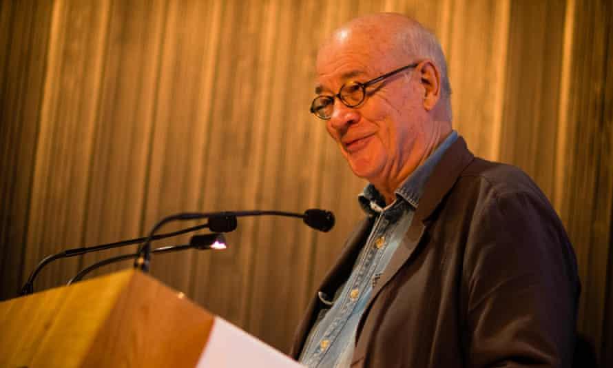 Martin Woollacott smiling at a podium