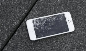 Apple iPhone with a cracked screen after a drop test from the DropBot