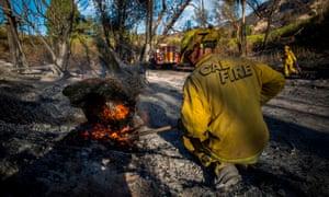 A firefighter controls a hotspot in Santa Paula, Ventura county, California.