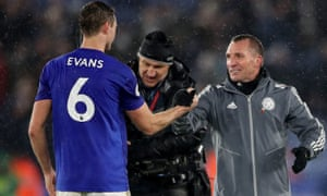 Jonny Evans celebrates with his manager after the impressive victory over Arsenal.