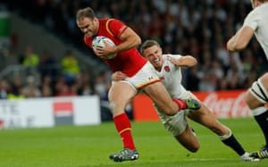 Jamie Roberts breaks through the tackle of Sam Burgess as Wales continue to press forwards