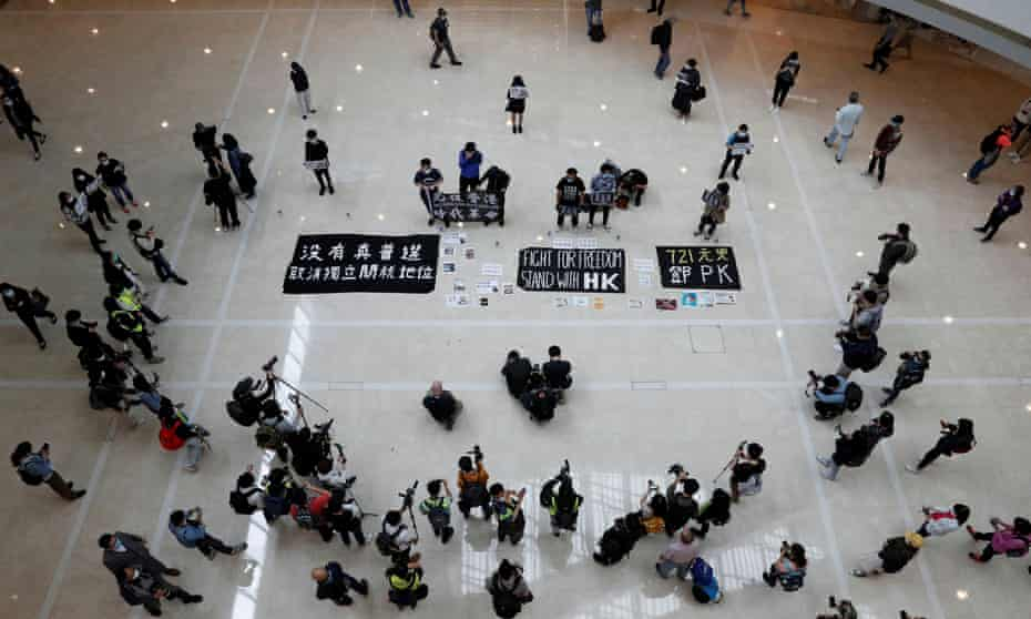 Anti-government protesters in Hong Kong stage a rally while obeying the social distancing rules during a lunchtime protest at a shopping mall on 24.
