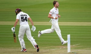 Sam Cook of Essex celebrates taking the wicket of Ben Green of Somerset.