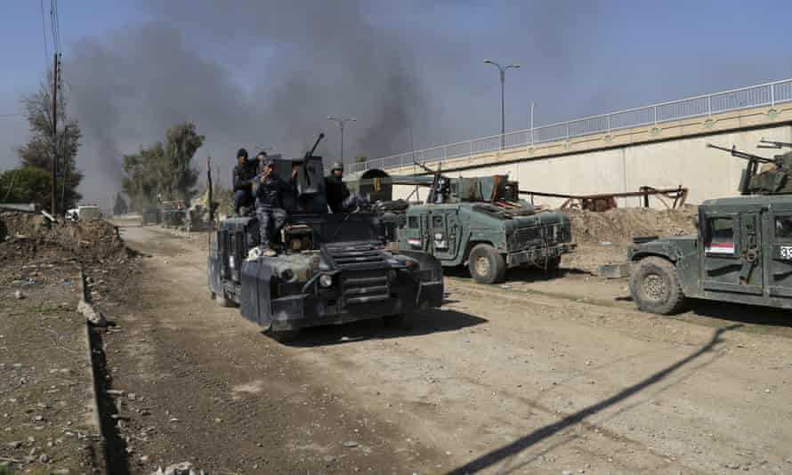 Iraqi security forces advance during fighting against Islamic State militants in western Mosul.