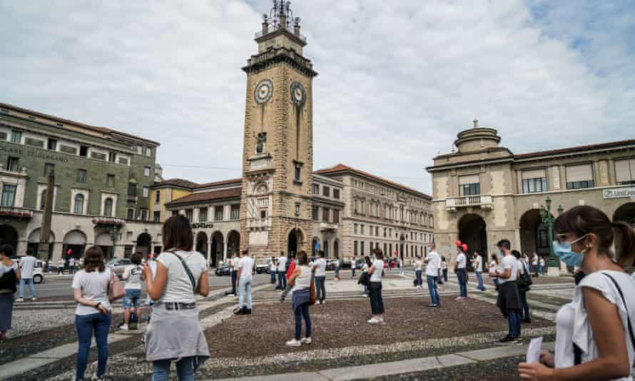 Nurses wearing masks stage a socially distanced protest this month in Bergamo.