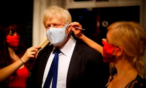 Artists put the finishing touches to a wax figure of Boris Johnson at Madame Tussauds in London ahead of its reopening on Saturday.