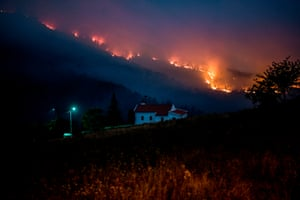 A wildfire burns in Vale da Cuba near Isna, Castelo Branco, 26 July