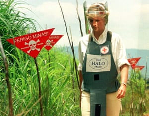 Diana, Princess of Wales walks through a safety corridor in a landmine field in Huambo, Angola, in 1997