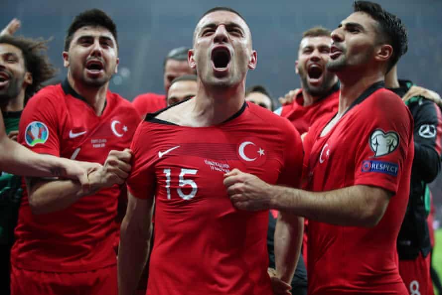 Turkey's Merih Demiral, centre, celebrates with teammates after Turkey secured qualification for the Euro 2020 finals.