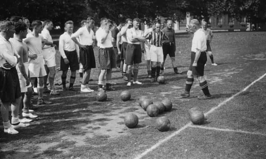 Jimmy Hogan, then Aston Villa's manager, addresses his squad in August 1936.