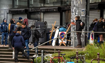 Students block an entrance to Lille 2 University's faculty of social, political and law sciences