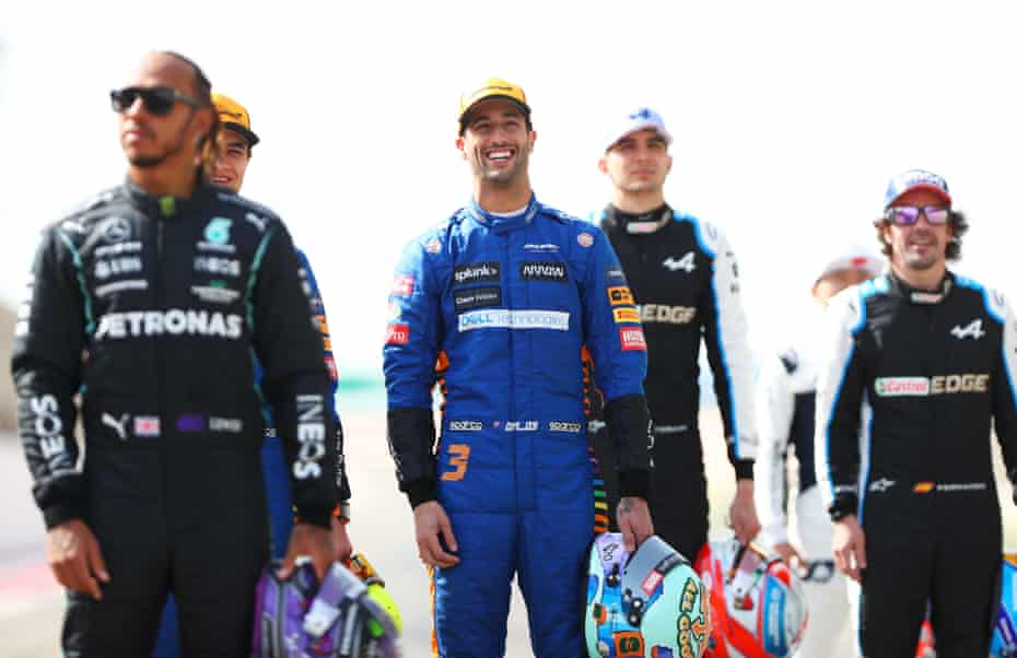 Daniel Ricciardo of McLaren smiles as he stands on the grid during day one of F1 testing in Bahrain last week.