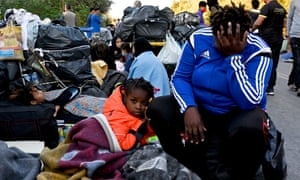 Refugees on the roadside after fires destroyed Moria camp on the island of Lesbos.