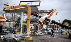 A police officer walks through a damaged gas station after a tornado touched down in the eastern part of New Orleans, Louisiana Tuesday.