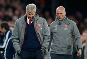 Arsene Wenger and Steve Bould look down at the end of the match.