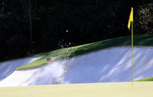 Rory McIlroy hits from a bunker on the 13th