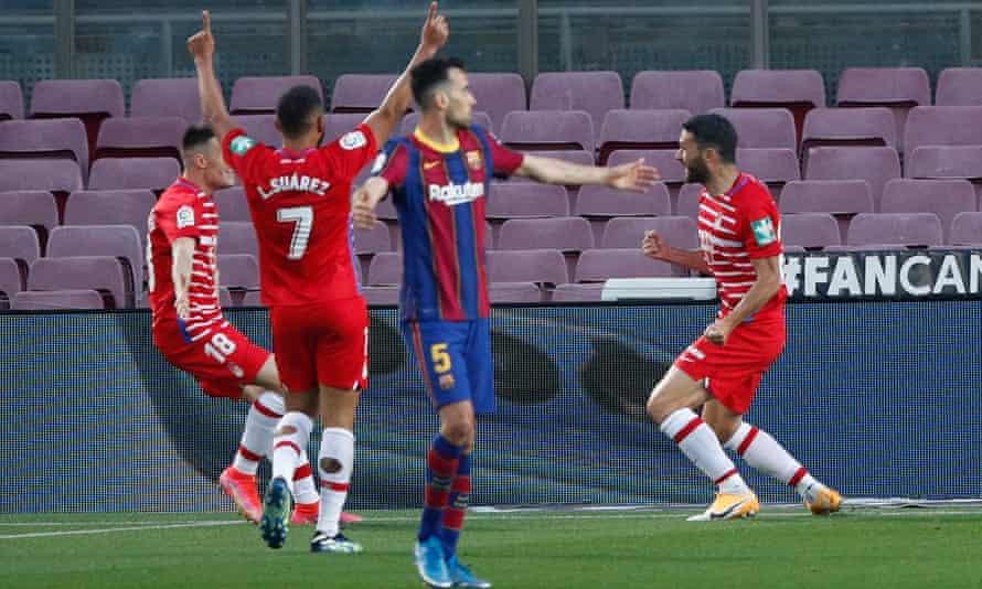 Barcelona's Sergio Busquets looks bereft after Jorge Molina gives Granada a 2-1 lead