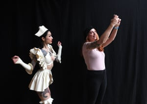 Women pose for a selfie at the London tattoo festival