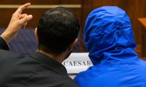 Caesar (disguised in a hooded blue jacket) listens to his interpreter before he speaks to the US House Committee on Foreign Affairs in Washington DC.