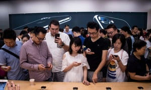 A year ago: customers testing the then-new iPhone 7 at an Apple store in Shanghai.