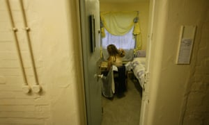 A female prisoner in her cell at Brockhill women's prison in Redditch, Worcestershire, UK.