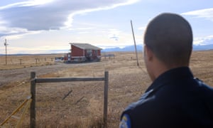 Police officer Isaiah Webber outside one of the reservation's 'party houses', one of the last places Ashley Heavyrunner Loring was seen.