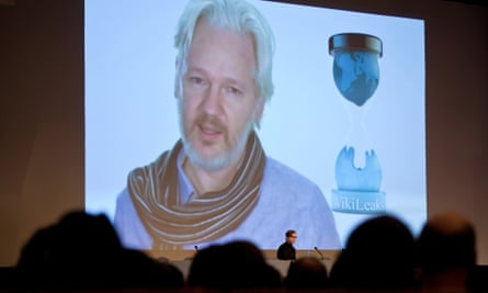 Jacob Appelbaum at the Chaos Computer Club, a European hacker gathering, during a video conference with Julian Assange.