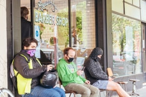 Men queue up for a haircut in Rathdowne St Carlton, after hairdressers are allowed to reopen during the coronavirus pandemic and associated lockdown. Coronavirus outbreak, Melbourne, Australia, on 25 October 2020.