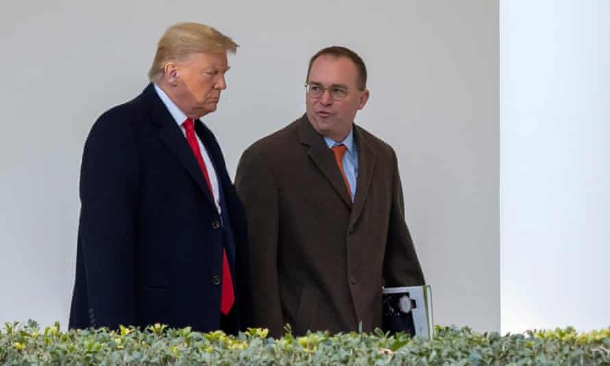 Mick Mulvaney, acting White House chief of staff, walks with Trump down the West Wing Colonnade.
