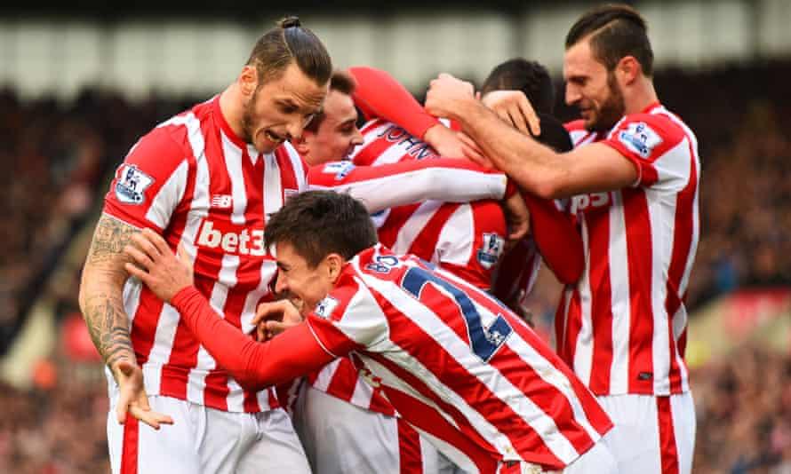 Bojan Krkic of Stoke City celebrates with Marko Arnautovic after scoring the opening goal against Manchester United.
