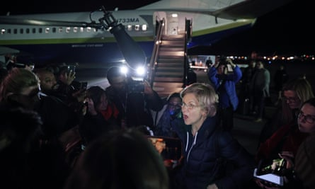 Elizabeth Warren arrives in Manchester, New Hampshire Tuesday after flying from Iowa.