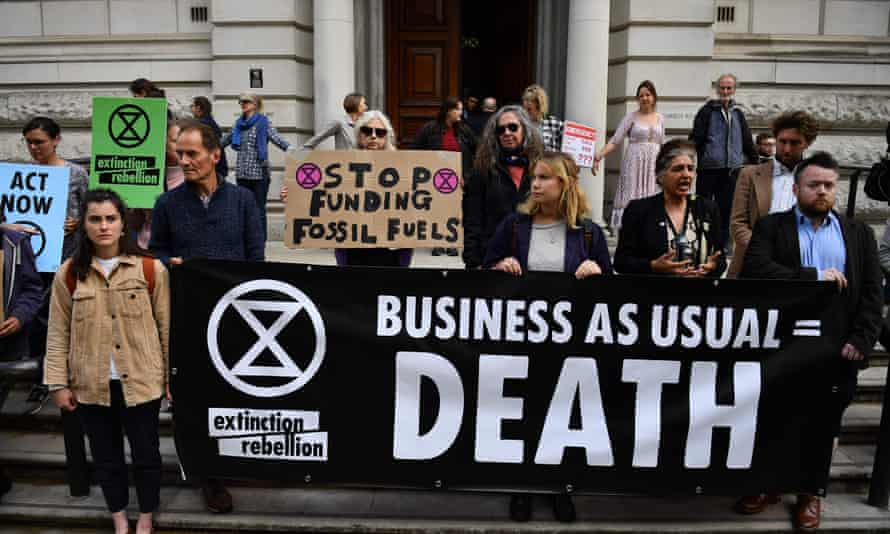 Extinction Rebellion activists protest outside the Treasury in London on 25 April 2019