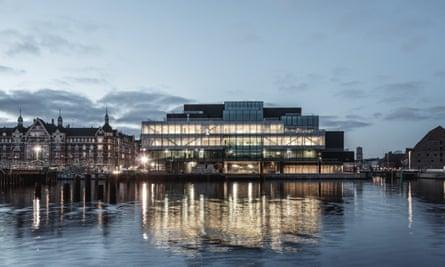 Exterior of an illuminated BLOX gallery in Copenhagen, Denmark, at dusk.