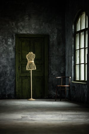 A tailor's mannequin in an empty room