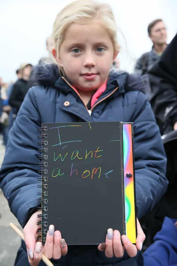 Nine-year-old Rebecca Cash, who lives with her mother in a bedsit, during Take Back the City's Dublin protest.