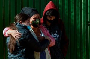 Relatives of a victim of Covid-19 who had left his remains for a week in the street as they had not been able to bury him in Cochabamba, Bolivia on 4 July, 2020.